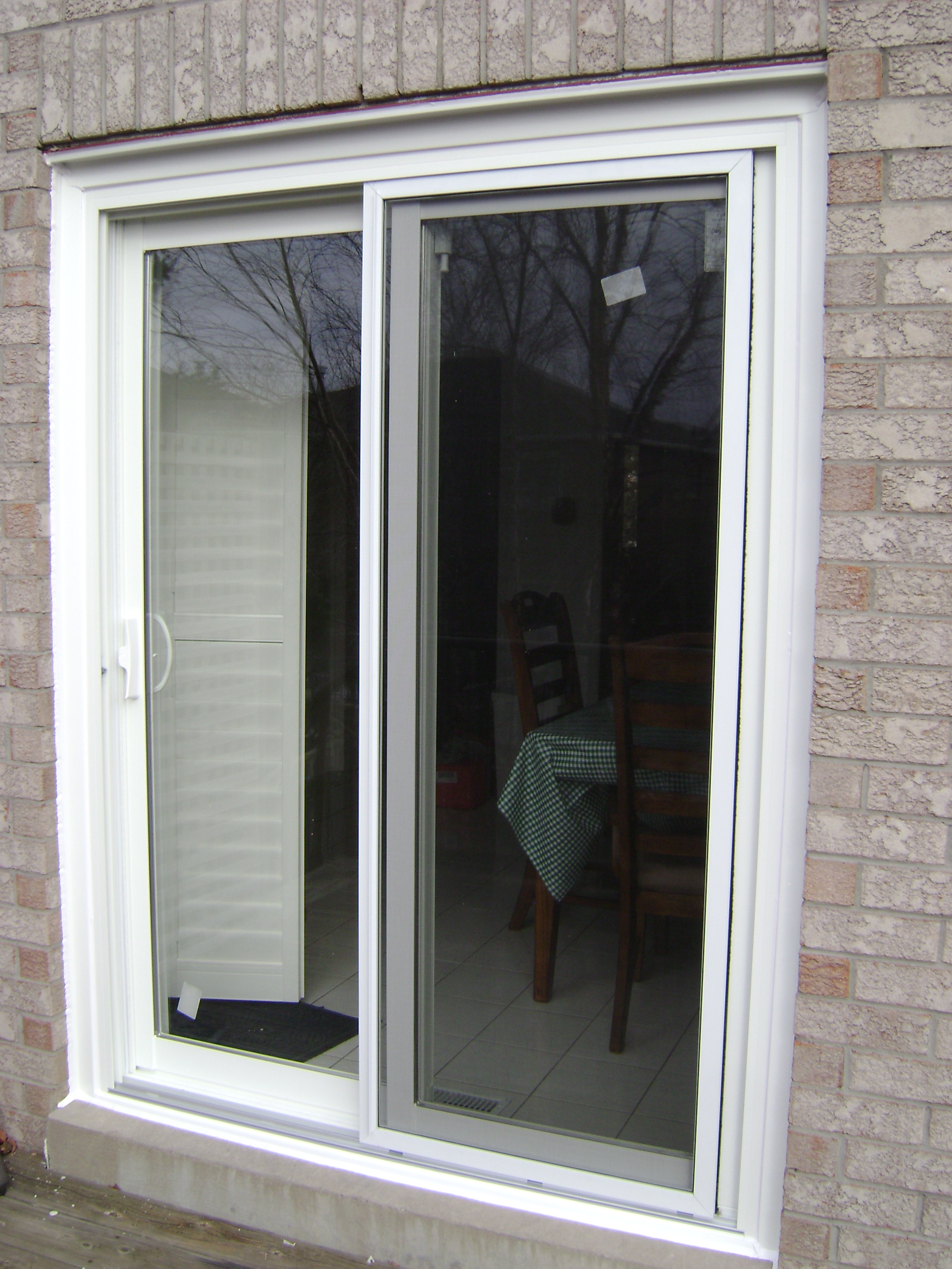 Patio door steel door fiberglass door patio door for Sliding patio windows